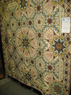 I'd like to know the story and provenance of this quilt. Anyone?