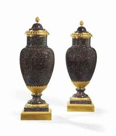 A PAIR OF LOUIS XVI STYLE ORMOLU-MOUNTED PORPHYRY COVERED VASES, 19TH CENTURY