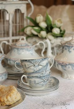 Vintage blue tea set and white tulips. Lovely.