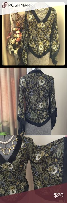Gorgeous LVL X Sheer Blouse Handkerchief styling.  This is a beauty.  Worn a couple times with TLC.  100% Rayon Georgette.  Dry Clean Only.  This item has recently been dry cleaned and has the tag.  One owner.  PRICE IS FIRM. LVL X Tops Blouses