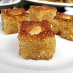 Basboosa, traditional Libyan recipe for a classic dessert of a semolina cake served with a lemon juice syrup. #recipe #libya #food #dalekh