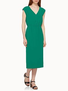 Exclusively from Contemporaine     A charming and very simply straight dress in pop-coloured crepe to touch up your summer wardrobe   Thin elastic waist seaming for a beautiful bloused look   Pockets hidden in the seams   Side slits for greater ease of movement   Full-length tone-on-tone lining    The model is wearing size 4