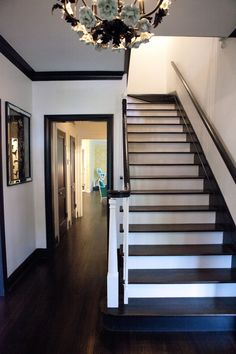 I'm just actracted to white walls and dark trim. Its one thing I want in my house. Black Trim Interior, Black Molding, Crown Molding, Moldings, Dark Wood Trim, Stained Trim, Black Stairs, Black Railing, White Staircase