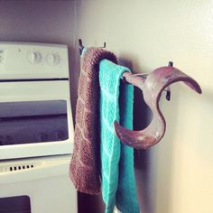 Towel holder made from my old branding irons and curtain rod holders!!! I'm in love with them in my home!!