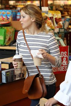 The Many Bags of Jennifer Lawrence Another casual brown crossbody! This one's the Ralph Lauren Collection RL Saddle Shoulder Bag.