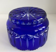 """This Nature Land Candles offering is for a 24% PbO Cobalt Blue Cut to Glass Sullivan Inc. Poland Crystal bowl. This large bowl is 8"""" wide and 5 1/2"""" tall. The bowl has a saw toothed rim, vertical lines and stars on the outside. The base has a clear thumb print design. The bottom of the bowl has a star design. I obtained this bowl at an estate auction. It is in excellent condition with no chips or cracks. Please see the pictures for details."""