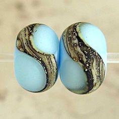 Hey, I found this really awesome Etsy listing at http://www.etsy.com/listing/61482748/handmade-glass-lampwork-bead-pair-etched