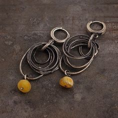 earrings, handmade of oxidized sterling silver (925), Baltic ambers signed © ewa lompe  D E T A I L S : amber (diameter ): 7- 8 mm total length : 5.5 cm or 2.1 inches  *This item is made to order, please about 7 business days for production.  The amber is a lightweight stone, every piece of amber is unique, so the item you receive will be similiar but not identical to the photo. Please be aware that each earring is made by hand and so there will be slight variatons in eaach piece.  S H I P P…