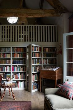 Incredible Home Libraries That Will Blow Your Mind This rustic home library has a hidden door.This rustic home library has a hidden door. Home Libraries, Reading Room, Reading Library, Library Books, Tiny Homes, Cabin Homes, Log Homes, My Dream Home, House Plans