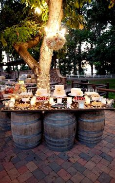 Outdoor dessert bar | This would be perfect. I love the barrels and reclaimed wood table top