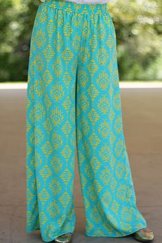 "EEEK! We are so in love with these flowy pants! The style and color are soooo Princess Jasmine!! :) With a stretchy waistband and soft material, it's never been easier to look and feel like royalty! :) Fits true to size. Miranda is wearing the small. Length: 40.5"" M- 41"" L- 41.5"""