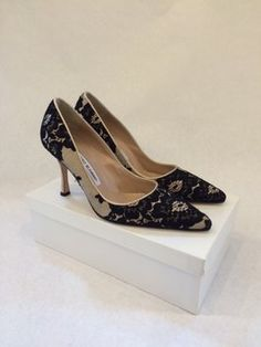 Manolo Blahnik Am - Tucciolabo Cream/ Black Pumps. Get the must-have pumps of this season! These Manolo Blahnik Am - Tucciolabo Cream/ Black Pumps are a top 10 member favorite on Tradesy. Save on yours before they're sold out!