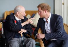 Prince Harry chats to 92 year old Anthony Colgan as he attends a reception for Normandy Veterans at Southwick House on June 2, 2016 in Portsmouth, England. The veterans, from across the armed forces, took part in the D-Day Landings and are attending the reception ahead of their annual pilgrimage to Normandy.