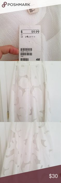 High Waisted A-Line Skirt New and unworn, white, floral detailed, A-Line Midi Skirt. The material is sturdy and high quality, but breathable as well. It would pair great dresses up with a blazer and tucked or cropped blouse or dressed down with a denim jacket and tank! No rips, stains or snags. And it has pockets! :)  I'd gotten it to wear with a crop top for a wedding as it is great for dressing up at a spring or summer event or night out, but it was a size too small and I missed the…