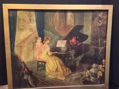 "It features a lady in a yellow dress playing the piano while a young girl watches. Overall dimensions including the frame are about 31"" x 26"". Condition is as seen in photos. 