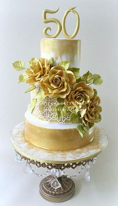 {Elegant golden Roses for this lovely Anniversary cake by D Cake Creations} 50th Birthday Cake For Women, Birthday Cake For Women Elegant, Birthday Cake Roses, 60th Birthday Cakes, Gold Leaf Cakes, Gold Cake, 50th Wedding Anniversary Cakes, Luxury Cake, Wedding Cake Stands