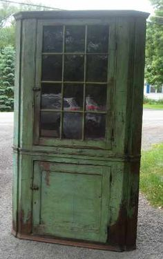 18th C. Corner Cupboard - green paint. Wavy, bubbly glass in the 12 lite door. 18th century piece.