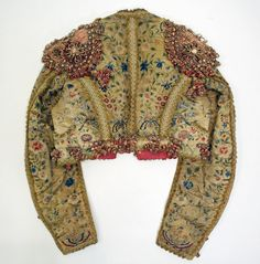 Spencer Coat or Jacket: Shortly worn indoors or out by both men and women that end at the waistline, in which women styles are worn just under the bosom.