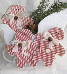Youll get three chipboard gingerbread men ready and waiting to hang on your Christmas tree! Each little guy has been embellished with a candy cane,