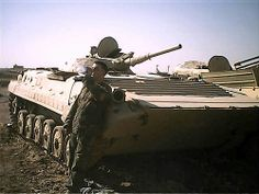 At derelict ex Iraqi Army BMP-1 in tank graveyard.