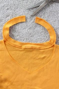 Change your crew neck t-shirts into a more flattering v-neck in a few simple steps without even adding any fabric. Watch the video tutorial!