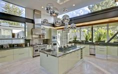 Glamorous Justin Bieber House with Modern Design, Best of Living Room, Terrific Circle Miror as Chandelier in The Clean and Chic Justin Bieber Kitchen Room