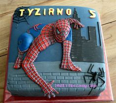 Spiderman Cake. Spiderman looks like he is coming out of the cake. What kid wouldn't love that?