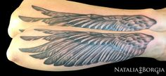 Wing tattoo on forearm.