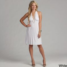 If you like nice Elan dresses, youll love this one featuring a unique T-back style. This classy yet casual dress has a banded empire waist that will make your figure look flattering, and the dresss deep V-neck can be accented by lovely jewelry pieces.