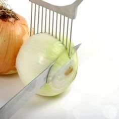 """""""ONION HOLDER""""....There's nothing more frustrating than trying to slice an onion into perfect rings. It's slippery, the outer ring starts to separate from the rest. This thing holds your onion in place for uniform slicing and less crying (in more ways than one!)."""