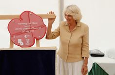 Camilla, Duchess of Cornwall unveils a plaque as she visits the Poppy Pod Village at the Tile Barn Outdoor Centre on July 26, 2016 in Brokenhurst, England. The Village stands on the site of a former First Word War Hospital and provides accomodation for service personnel and their families. - The Duchess of Cornwall Visits Commonwealth War Graves & Opens Poppy Pod Village