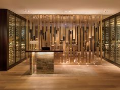 Metal brass partition, wine display marble welcome counter Rockwell Group