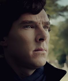 THIS is the real photo of Sherlock watching John in the graveyard. Sad, but no tears or red eyes.