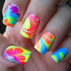 Neon water marble nail art. Includes all the hottest neon hues of polish colors to get the complete look. Available exclusively at Cult Cosmetics.