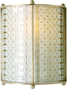 A unique, one-light sconce provides a glittering, yet softly diffused light from its Ivory chinette shade, elegantly sheathed in brilliant glass tiles. A patinaed brass frame finishes the piece.