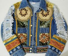 ☩BOHEMIAN DENIM JACKET    70s vintage customised jacket by crux and crow  Antique/vintage patchwork and trims  Fringing and embroidery  Old velvet and tapestry  Distressed sleeve panels with studs  Only one!    Label: Crux and Crow  Size on tag: -  Best fit: XS S  Fabric: Denim  Condition: Excellent    The item pictured is the one youll receive!    ☩M E A S U R E M E N T S    Length: 53cm (21)  Bust: 49cm (19) Waist: 41cm (16)  Sleeve: 59cm (23)    Measurements taken with garment laying…