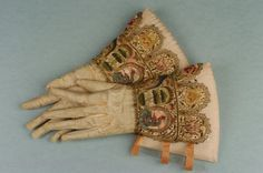 A pair of men's embroidered gauntlet gloves with long extended fingers, circa 1620 – 1635