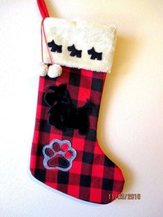 """IT MEASURES 18"""" LONG BY 10"""" WIDE AT THE FOOT AND 8"""" WIDE AT THE TOP. BLACK AND RED PLAID WITH BEIGE FUR AT THE TOP AND FULLY LINED. ONE LARGE 5"""" X 5"""" SCOTTIE APPLIQUE AND 3 1-1/2"""" X 1-1/4"""" SCOTTIES.   eBay!"""