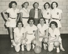 The NYU women's basketball team in 1953. Back then, the women's uniform included a skirt!