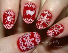 White and red laces Christmas nail art. Paint your nails in adorable lace patterns using white polish and add reindeer and snowflakes details to make the design even more attractive.