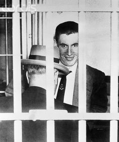 May 15, 1956 - Doomed. Canon City, Colorado: Convicted slayer John Gilbert Graham manages a smile   as he enters the death cell in the Colorado State penitentiary here May 15th. Graham, killer of 44 persons,   one of them his own mother, in a plane bombing, is scheduled to die the week of August 26th.