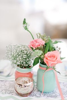 mint baby's breath and coral roses in mason jars wedding centerpieces