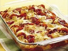4-Ingredient Pizza Bake by Betty Crocker Recipes Ingredients:  2 pouches (7.5 oz each) Bisquick® Complete buttermilk biscuit mix 1 cup water 1 jar (14 oz) pizza sauce 1 package (8 oz) sliced pepperoni 2 cups shredded mozzarella cheese (8 oz)  Directions:  1. Heat oven to 375°F. Spray 13x9-inch (3-quart) glass baking dish with cooking spray. In medium bowl, stir Bisquick mix and water until soft dough forms. Drop half of dough by spoonfuls evenly in bottom of baking.......