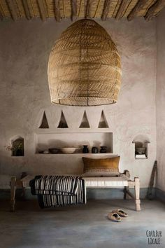 beautiful Moroccan home decorated by Couleur Locale - hand woven pendant lamp shade, hand made furnishings, hand finished Tadelakt (traditional plaster walls)