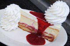 Lemon Raspberry Cream Cheesecake ~   Ladyfingers serve as the crust, and the lemon cheesecake filling is swirled with raspberries; it's all topped with lemon mousse, raspberry puree, and whipped cream.