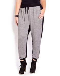 So chic and comfy! This jogger pant features elastic waistband with drawstring and pockets. 30 inch inseam. Add high heels and cute accessories for a stylish look!