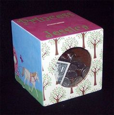 I decoupaged this whimiscal coin bank for my grandaughter. I included her photo from Disney World on one side and the other sides from disney themed high quality scrapbook paper. This box was built by a master carpenter and is made strong to last. Its a 5 1/2 inch cube. This is a large bank that will hold many coins. It has a plexiglass window for her to see her savings add up.