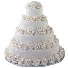 Rose and stephanotis blossom borders add distinctive detail to this cake design. Would you add any color to this cake – or leave it as it is? Click here for decorating instructions http://s.wilton.com/14aUZp4