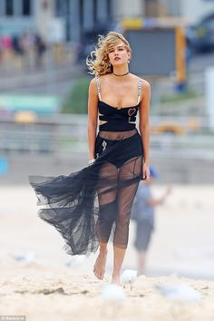 Ample assets:Karlie Kloss, 24, continues to make quite an impression Down Under, with the American model putting on a busty display at Bondi Beach on Thursday