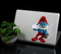 Papa Smurf Macbook Decal / Our finest vinyl decals are made with highest quality transparent vinyl, so that the image blends in with the colour of Macbook perfectly, all the edges and the apple logo cut out are precisely tailored. http://thegadgetflow.com/portfolio/papa-smurf-macbook-decal-22/